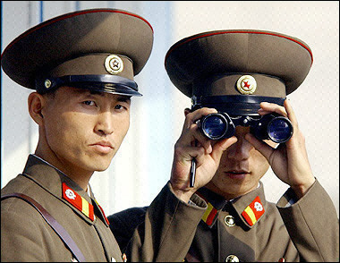 http://www.peatbog.net/wp-content/uploads/2006/02/North%20Korea%20Border%20Guards.jpg